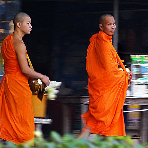 MONKS ASKING FOR ALMS. AYUTTHAYA. THAILAND.
