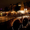 CANALS AT NIGHT. PINK TOWER OF WESTERKERK. AMSTERDAM. NOORD-HOLLAND. THE NETHERLANDS.