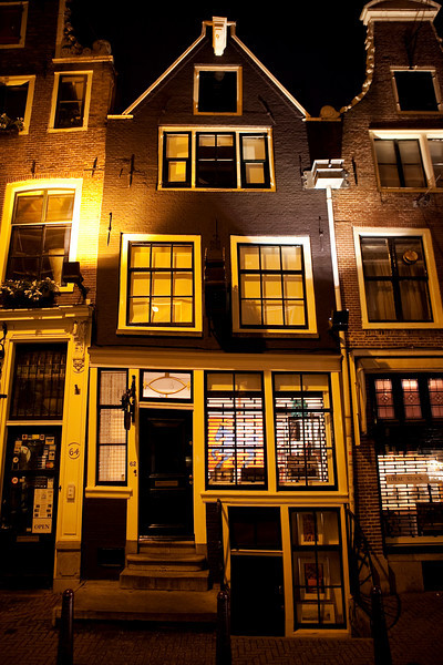 OLD DUTCH HOUSES AT NIGHT. NIEUWE SPIEGELSTRAAT. AMSTERDAM CENTRE. THE NETHERLANDS.