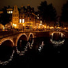 CANALS AT NIGHT. AMSTERDAM. NOORD-HOLLAND. THE NETHERLANDS.