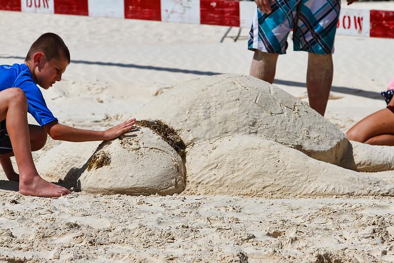 Kids creating a Sea Turtle from sand on Eagle Beach, Aruba-2014