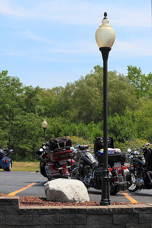 IMG#4445 July 23, 2011 - DAY 1 Our bikes in the nicely appointed parking lot of  a Vermont Harley Davidson dealership...