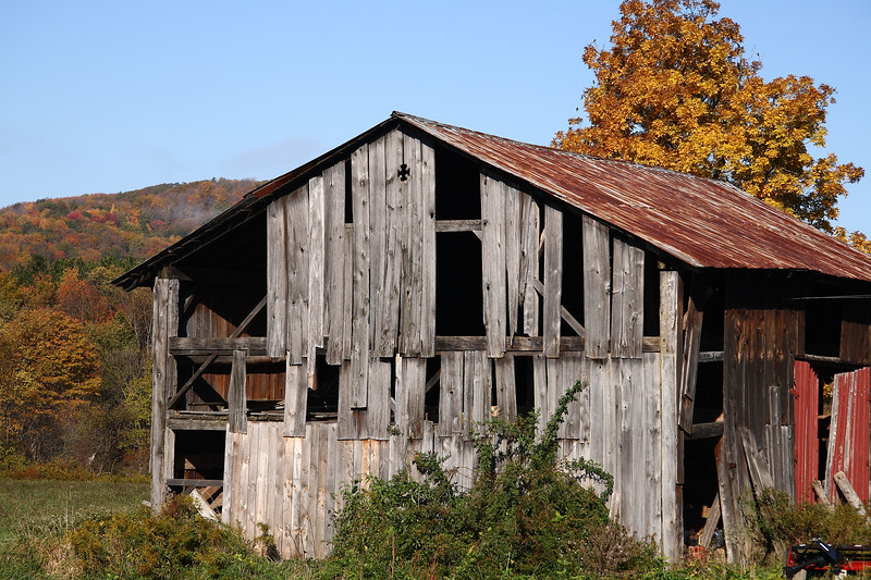 <center>IMG#5614 The sun comes up on an old, broken barn alongside a country road in  Warren county, Pennsylvania October 10, 2010<center>