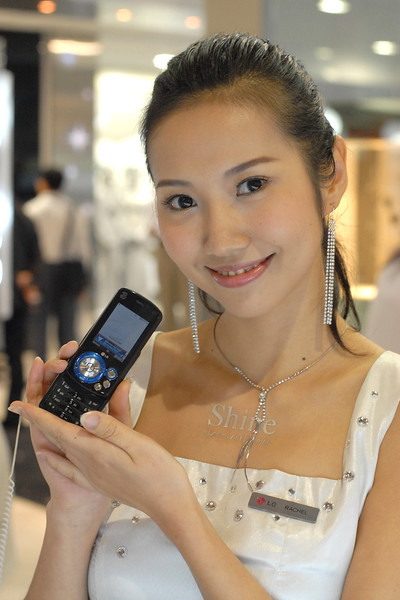 Model showing the LG shine mobile phone at the CommunicAsia exhibtion in 2007 at Singapore Expo, Singapore.