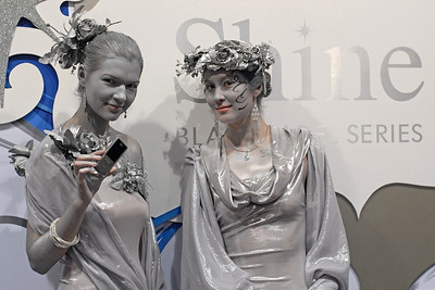 Models display the LG Shine mobile phone at the CommunicAsia exhibition and conference in Singapore.