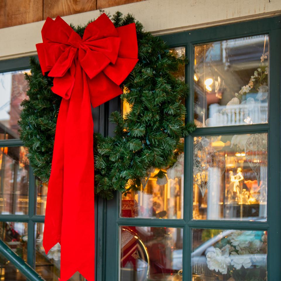 A simple wreath adorns a shop window