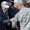 10th Mountain Division veteran puts new 10th Mountain patch on National Guard soldier
