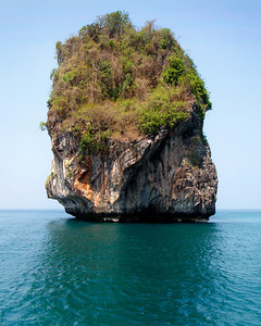 Floating Island - Thailand  Huge limestone karst towers, eroded from the outside by the action of water and biological erosion, stand like giant teeth in the bays of southern Thailand. Each one is capped with a micro-jungle, nourishing itself from subterranean pools and aquifers that hold the rainwater.