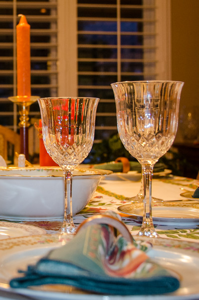 Crystal and candles adorn the table