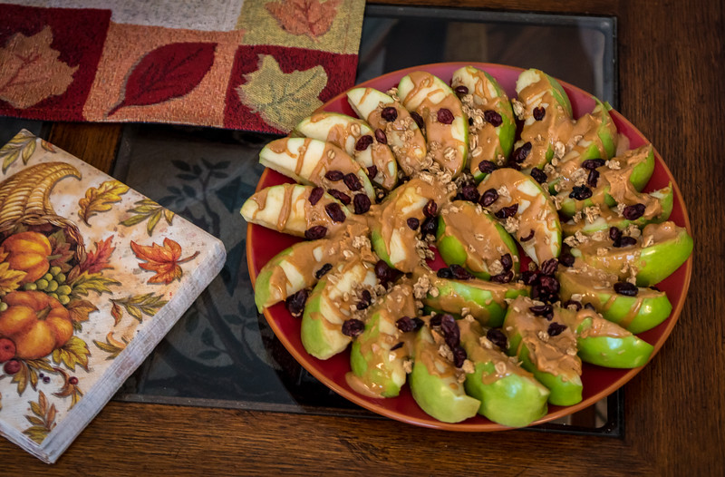 Sliced apples drizzled with peanut butter
