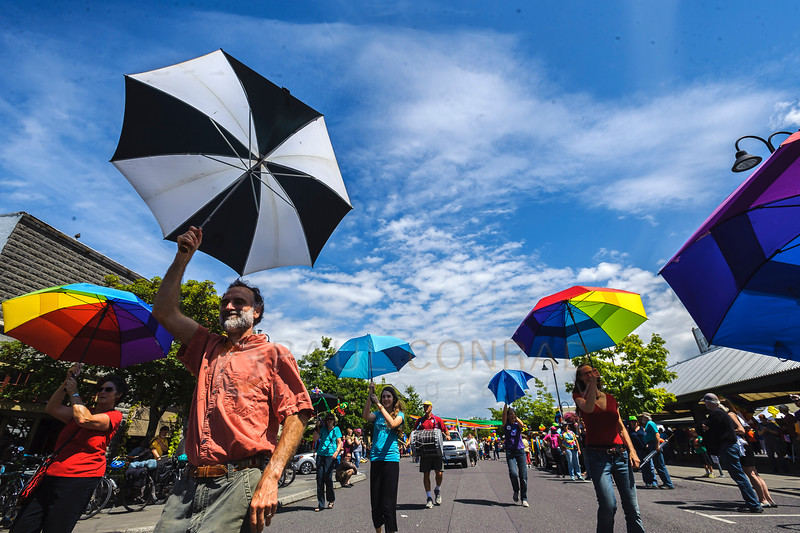 Members of the Umbrella Brigade perform for the onlookers during the 2016 Bellingham Pride Parade on Railroad Avenue in Bellingham, Wash. (© Paul Conrad/The Bellingham Herald)