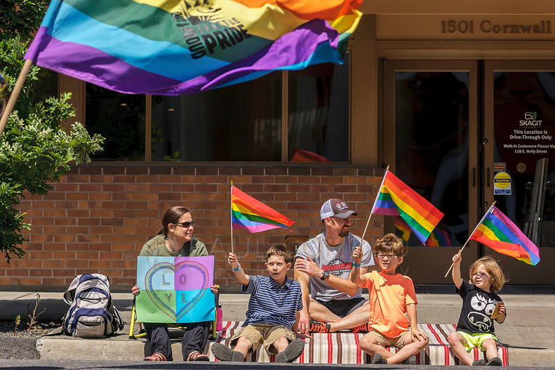 Ayn Witman and her famly; Nolen, 8; Branden; Alex, 6; and Kellen, 3: cheer the 2016 Bellingham Pride Parade as it passes on Cornwall Avenue on Sunday morning July 10, 2016, in Bellingham, Wash.