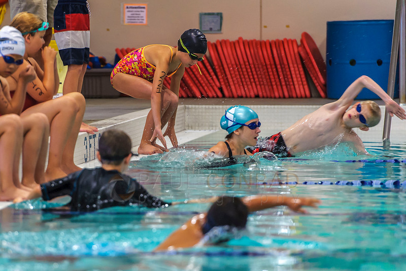 Braeden Loeffelholz, right, 10, dives into the pool during the start of the Division 2 triathlon of the 2016 Youth Triathlon on Sunday morning Aug. 7, 2016, at the Arne Hanna Aquatic Center in Bellingham, Wash. (© Paul Conrad/The Bellingham Herald)