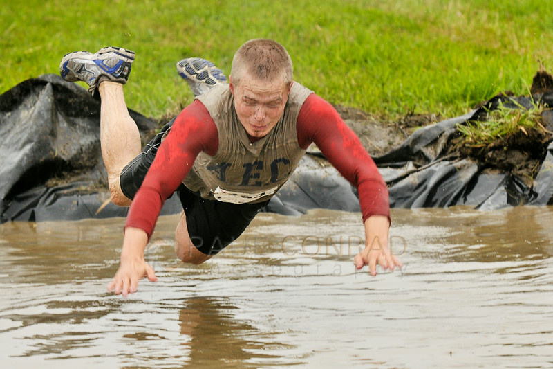 © Paul Conrad/The Bellingham Herald - A competitor dives into a mud pit during the 3rd annual Mud to Suds race on Saturday morning August 16, 2014, at Hovander Park in Ferndale, Wash. Nearly 2000 people ran the 2.5 mile course negotiating 22 obstacles including mud-filled pits, hay bales, and a soap foam tunnel. The event raised funds for the Girls Scouts of Western Washington.