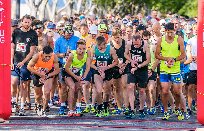 Dillon Quintana (291), left in orange, and other competitors start their personal timers at the beginning of the 50th annual Chuckanut Foot Race on Saturday morning July 9, 2016, in Fairhaven, Wash. (© Paul Conrad/The Bellingham Herald)