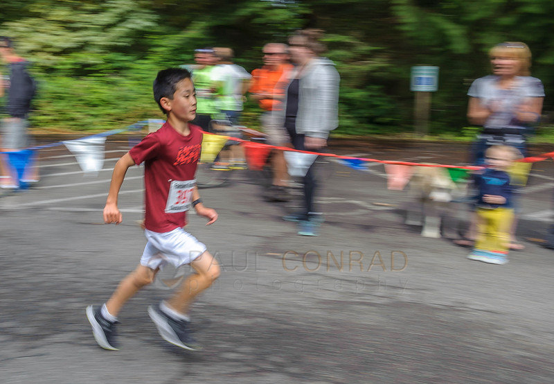 Reese Watabayashi, 13, approaches the finish line during the 50th annual Chuckanut Foot Race on Saturday morning July 9, 2016, in Fairhaven, Wash. Watabayashi ran the 7 mile course in 57 minutes, 31.2 seconds. (© Paul Conrad/The Bellingham Herald)