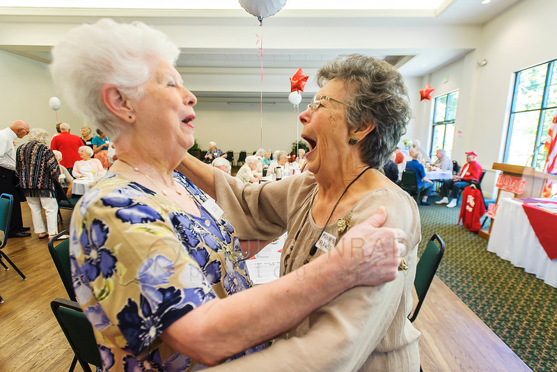 Long time friends Fontella Lindquist, left, and Maxine Bell Rawls get excited while reuniting during the 70th reunion for the Bellingham High School Class of 1946 on Sunday afternoon Aug. 14, 2016, at Northwood Hall in Bellingham, Wash. Althought they attended separate high schools, the two say they have known each other since grade school. (photo © Paul Conrad/The Bellingham Herald)