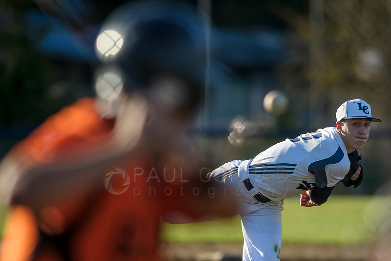 Lynden Christian pitcher Peyton Robertson (7) throws to Blaine during the fourth inning on Thursday afternoon Mar. 30, 2017, at Lynden Christian High School in Lynden, Wash. Blaine defeated Lynden Christian 12 to 5 extending their undefeated season. (© Paul Conrad/The Bellingham Herald)