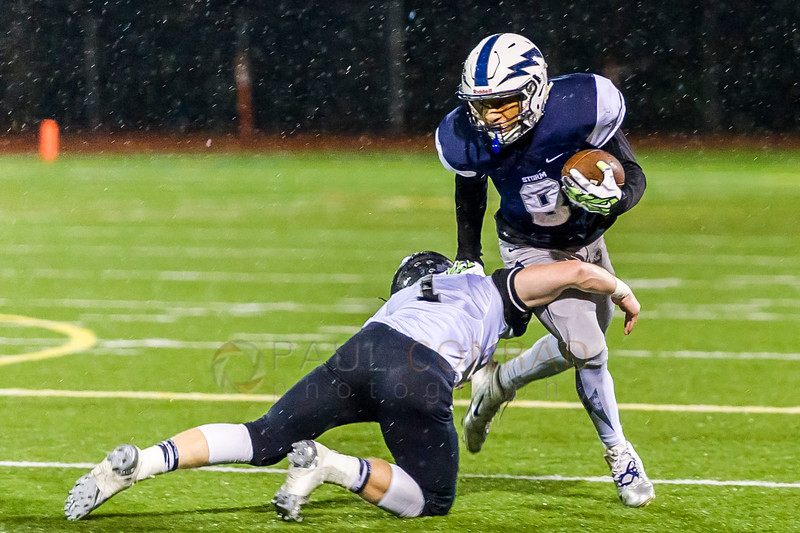 Sweeping the Left - Squalicum's Damek Mitchell (8) escapes the grasp of Bonney Lake's Braydon Tressler (1) behind the line of scrimmage during the second half of the 3A state playoff on Friday evening Nov. 11, 2016, at Civic Stadium in Bellingham, Wash. Mitchell continued the run for an extra 10 yards. The Storm's 24-7 loss to the Panthers ended their running in the Class 3A state playoffs. (© Paul Conrad/The Bellingham Herald)