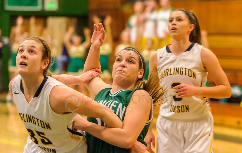 Burlington-Edison def. Lynden 54 to 50 - Lynden's Mariah Gonzalez (10) struggles against Burlington-Edison's Delaney Watson (35), left, during a third quarter free throw in the Class 2A Northwest District Championship varsity girls semi-final game on Monday evening Feb. 13, 2017, at Mount Vernon High School in Mount Vernon, Wash. Burlington-Edison defeated Lynden 54 to 50 to advance to the championship. (© Paul Conrad/The Bellingham Herald)
