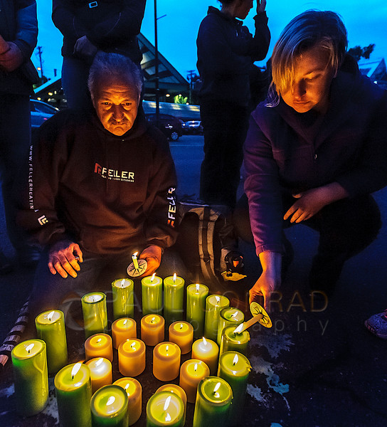 Tony Mansanarez, left, of Salt Lake City, and Kaitlin Davis of Bellingham attend the candlelight vigil for the victims of the Orlando, Fla., nightclub massacre on Monday evening June 13, 2016, at Rumors Cabaret in Bellingham, Wash. Over a hundred people turned out to honor those killed in the terrorist attack. Organizer Heidi O'Hana said she she was