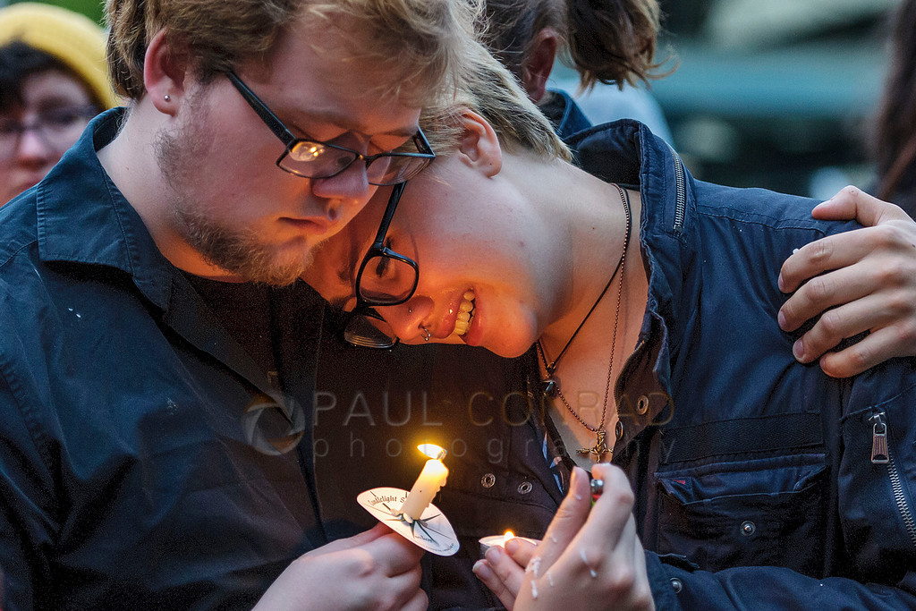 A couple hugs while listening to the names of the deceased of the Orlando nightclub massacre during a candlelight vigil on Monday evening June 13, 2016, at Rumors Cabaret in Bellingham, Wash. Over a hundred people turned out to honor those killed in the terrorist attack. Organizer Heidi O'Hana said she she was