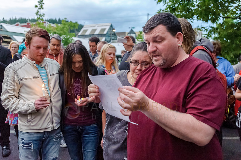 Bille Jones (cq), right, reads a list of the victims of the Orlando nightclub attack during a candlelight vigil on Monday evening June 13, 2016, at Rumors Cabaret in Bellingham, Wash. Jones is comforted by friend Kasandra Boote as he reads. Over a hundred people turned out to honor those killed in the terrorist attack. Organizer Heidi O'Hana said she she was