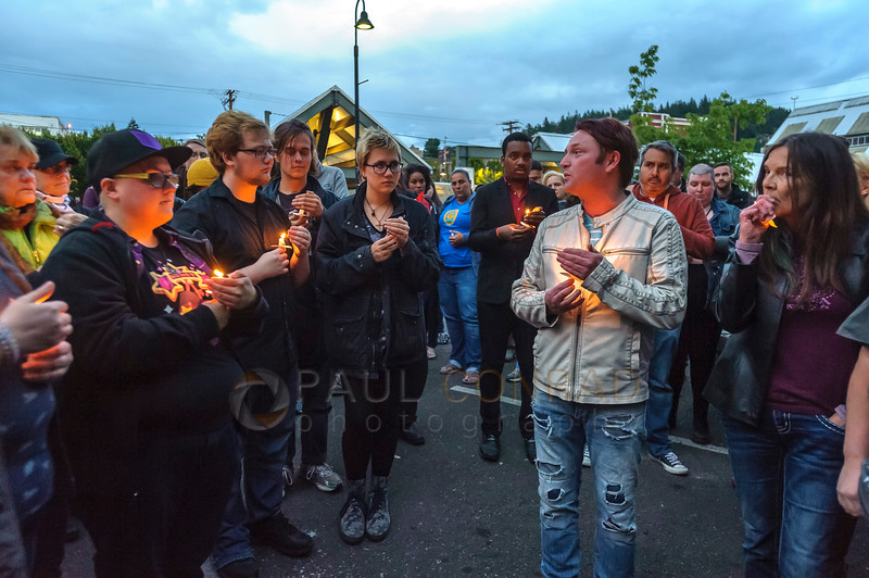 Lonny Vinge of Bellingham, 2nd from right, says a few words candlelight vigil for the victims of the Orlando, Fla., nightclub massacre on Monday evening June 13, 2016, at Rumors Cabaret in Bellingham, Wash. Over a hundred people turned out to honor those killed in the terrorist attack. Organizer Heidi O'Hana said she she was