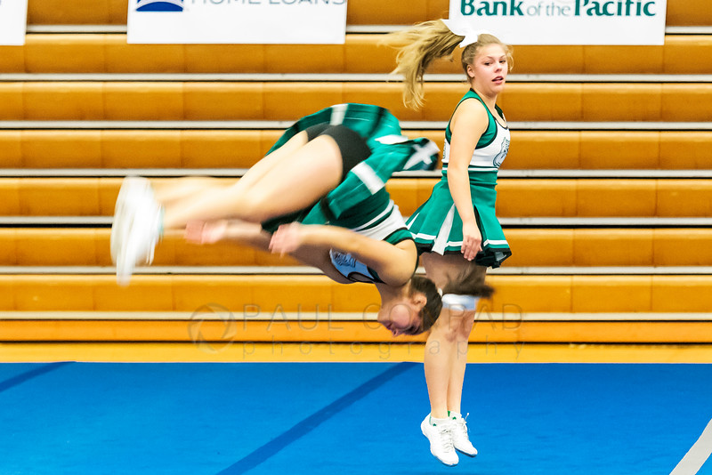 Flipping In - Members of the Mt. Vernon High School cheerleading squad take to the mat to perform during 2016 Cheerfest hosted by the Northwest SilverStars on Saturday afternoon Nov. 5, 2016, at Meridian High School in Laurel, Wash. (© Paul Conrad/The Bellingham Herald)