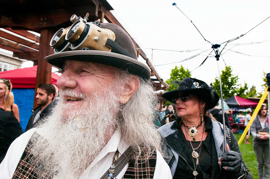© Paul Conrad/The Bellingham Herald - Jim 'Dirty Dan' Rich, left, and Valerie Snelling during the Fairhaven Steampunk Festival at Fairhaven Village Green in Fairhaven, Wash.,  on Saturday afternoon July 19, 2014. Hundreds enjoyed the sights of individuals dressed in Steampunk Victorian costumes, live entertainment, food and vendors .