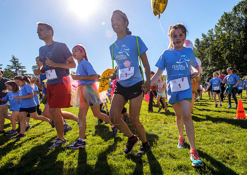 Participants take off from the start during the 2016 Girls On The Run 5K on Saturday morning June 4, 2016, at Lake Padden in Bellingham, Wash. GOTR director Jen Gallant said over 700 people registered for the fun run which included 400 participants in the GOTR and Trailblazer program as well as 300 adults from various YMCAs around the Puget Sound. She added GOTR is a YMCA after school program designed to encourage positive emotional, social, mental, spiritual and physical development. (© Paul Conrad/The Bellingham Herald)