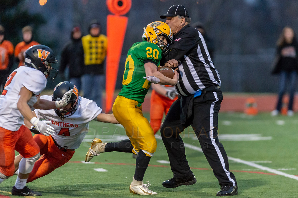 Lynden defeats Washougal 29 to 26 -  Lynden running back Steven DiLorenzo runs into the referee as he breaks through the Washougal defense during the fourth quarter in their Division 2A quarter-final game on Saturday afternoon Nov. 23, 2019, on Civic Field in Bellingham, Wash.. Lynden defeated Washougal 29 to 26 to advance in the playoffs. Lynden is to play Steilacoom on Nov. 30th.(photo © Paul Conrad/Paul Conrad Photography)