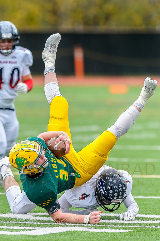 Gaining Yardage - Lynden's Brody Weinheimer (35) flips over as he is tackled by Black Hills' Ethan Loveless (4) after a short gain during the third quarter in the 2A state first round playoff varsity football game on Saturday afternoon Nov. 12, 2016, at Civic Stadium in Bellingham, Wash.