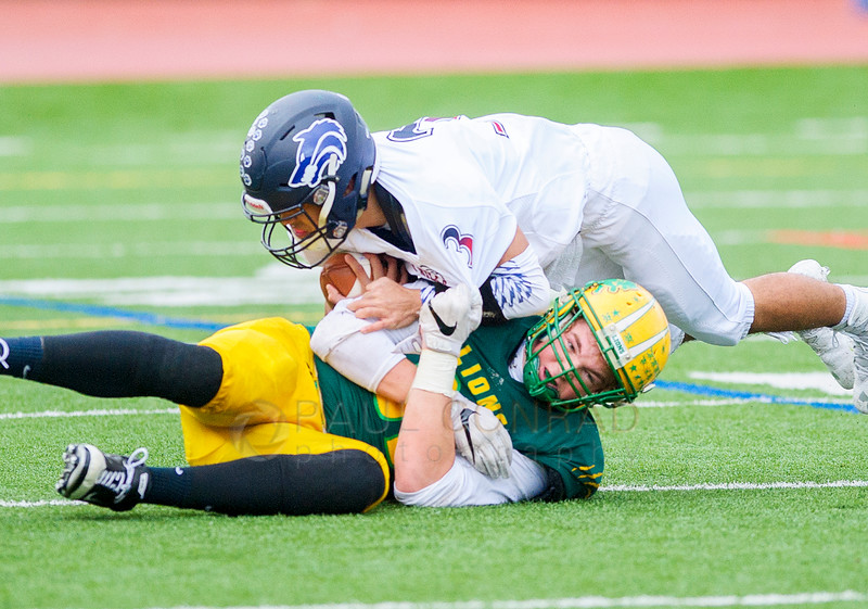 Three Finger Hold - Lynden's David Bode holds tight onto Black Hills' Christian Williams (3) behind the line of scrimmage during the second quarter in the 2A state first round playoff varsity football game on Saturday afternoon Nov. 12, 2016, at Civic Stadium in Bellingham, Wash. (© Paul Conrad/The Bellingham Herald)