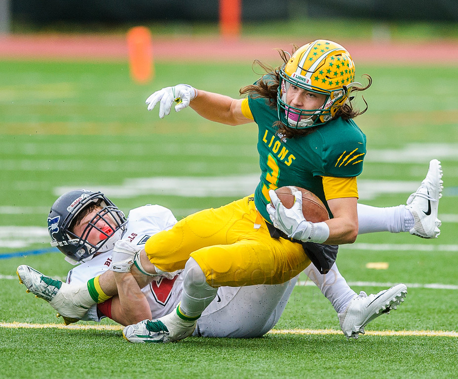 By the Shoe - Black Hills' Taylor Simmons (21) pulls down Lynden's Rylan Severson at the lie of scrimmage during the third quarter of the 2A state first round playoff varsity football game on Saturday afternoon Nov. 12, 2016, at Civic Stadium in Bellingham, Wash. (© Paul Conrad/The Bellingham Herald)
