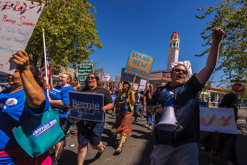 Kelley Whitty, right, chants with nearly 200 Bernie Sanders supporters while marching down Commercial Street during the from the March for Bernie Rally on Saturday afternoon July 24, 2016, at Maritime Heritage Park in Bellingham, Wash. (© Paul Conrad/The Bellingham Herald)