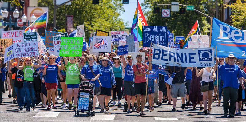 About 200 marchers file down West Holley Street during the March for Bernie Rally on Saturday afternoon July 24, 2016, in downtown Bellingham, Wash. (© Paul Conrad/The Bellingham Herald)