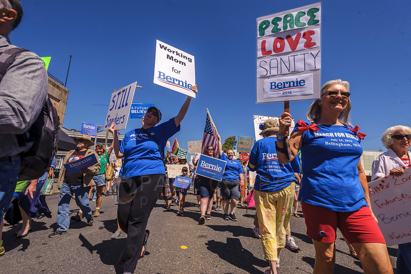 About 200 marchers file down Commercial Street during the March for Bernie Rally. (© Paul Conrad/The Bellingham Herald)