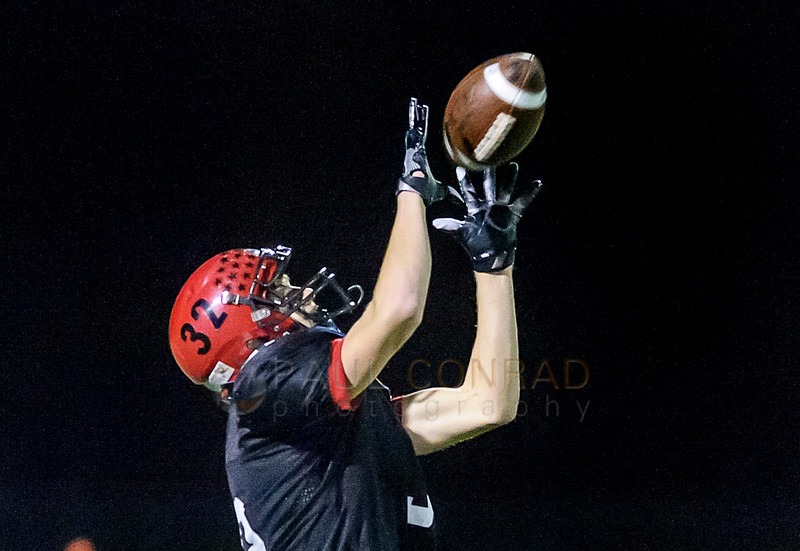 Touchdown Catch - A wide open Thomas Barbo (32) with Mount Baker catches a long pass from quarterback Kaleb Bass (12) deep in the secondary of Hoquiam minutes into the first quarter their District 1A state playoff game on Saturday evening Nov. 12, 2016, at Civic Stadium in Bellingham, Wash. Barbo completed the pass and ran it into the end zone for a touch down. The resulting two point conversion catapulted Mount Baker ahead of Hoquiam 8 to 0. (© Paul Conrad/The Bellingham Herald)