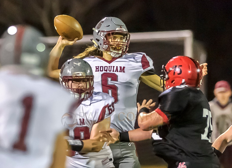 Fear in his Eyes - Hoquiam's Gregory Dick (6) gets pressured from Mount Baker's Maxwell Tolman (75) during the second quarter in the Division 1A state playoff game on Saturday evening Nov. 12, 2016, at Civic Stadium in Bellingham, Wash. (© Paul Conrad/The Bellingham Herald)