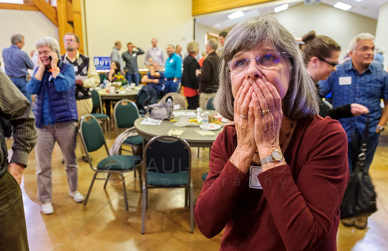 Carole Perry of Bellingham watches intensely the Presidential election results during the post election party for the Republican Party at the Mt. Baker Rotary Building on Tuesday Nov. 8, 2016, in Lynden, Wash. (© Paul Conrad/The Bellingham Herald)