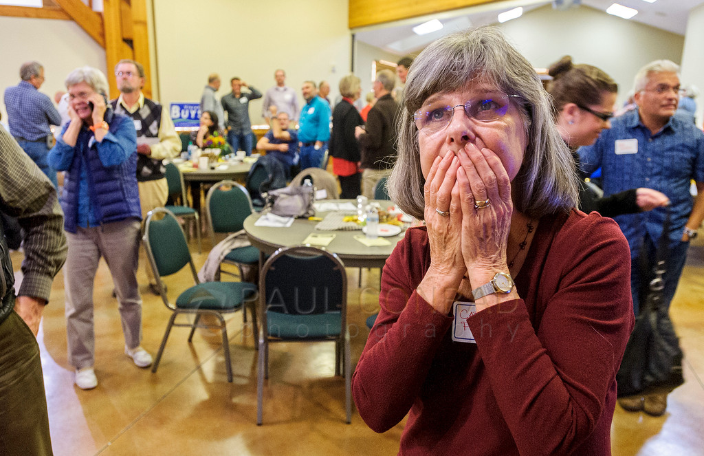 Anxiety - Carole Perry of Bellingham anxiously watches the Presidential election results during the post election party for the Republican Party at the Mt. Baker Rotary Building on Tuesday Nov. 8, 2016, in Lynden, Wash.   (© Paul Conrad/The Bellingham Herald)