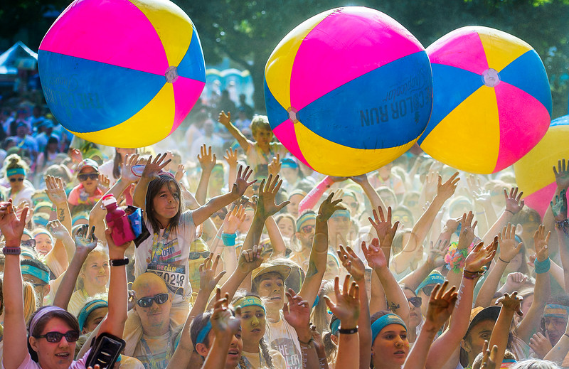 Participants dance and play with oversized beach balls at the after party during The Color Run on Sunday morning Aug. 21, 2016, in downtown Bellingham, Wash. Several thousand participated in the