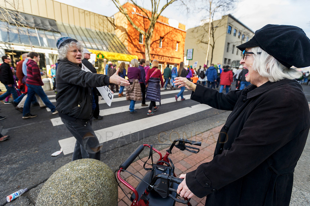 Elderly Solidarity - Patricia Stevenson, 86, right, is greeted by a protester during the Women's March on Bellingham on Saturday Jan. 21, 2017. (© Paul Conrad/The Bellingham Herald)