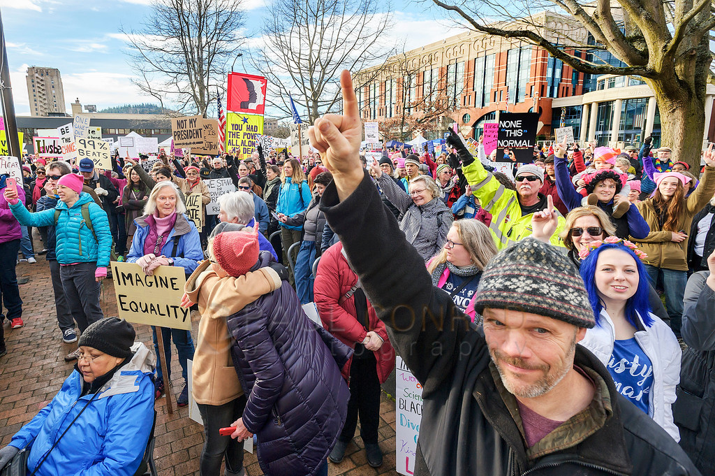Men in Solidarity - Bob Penny, right, of Bellingham signals his support for the Women's March on Bellingham. (© Paul Conrad/The Bellingham Herald)