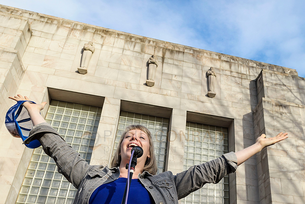 Belting the Anthem - Bellingham singer Sarah Goodin belts out the Star Spangled Banner during the Woman's March on Bellingham Saturday Jan. 21, 2017, at Bellingham City Hall in downtown Bellingham, Wash. Thousands gathered at city hall to protest the policies of President Donald Trump and in solidarity with the Women's March on Washington and others throughout the United States and in other countries. (© Paul Conrad/The Bellingham Herald)