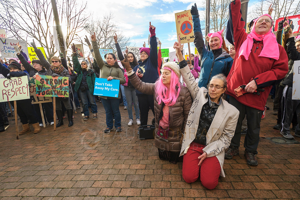 Moment of Silence - Marchers take a moment of silence during the Women's March on Bellingham. Thousands gathered at city hall to protest the policies of President Donald Trump. Protests and marches were planned throughout the United States and in other countries. (© Paul Conrad/The Bellingham Herald)