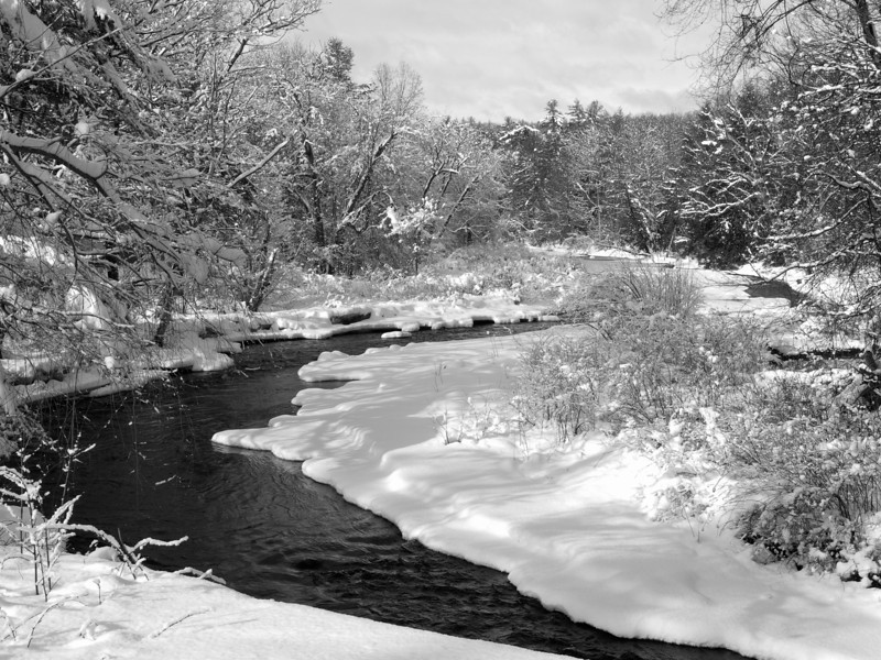 Jan 2010, New Boston, NH<br /> Piscataquog River<br /> Taken from a bridge...wrong shoes for going mucking about in snow...I think it came out well and I didn't even get run over!<br /> <br /> Why it's in the best of 2010 - because even if I had planned this shot and spent a lot of time framing and composing, it couldn't have been done better.  As it was it was a grab shot that took me only seconds to shoot.  The Piscataquog is a very picturesque river and so it's hard to get a bad image of it, but I like this one particularly because of the strong S curve of the dark river that leads your eye right through the frame.  The white snow is almost blinding in spots, but the surrounding trees and sky keep your eyes in the shot.  Someone commented that she expected to see a group of barbarians on horseback come bursting through and I love that.