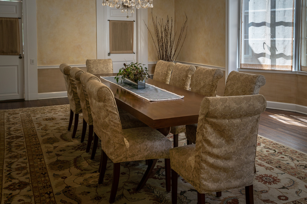 Formal dining room in gold at the Boddy House