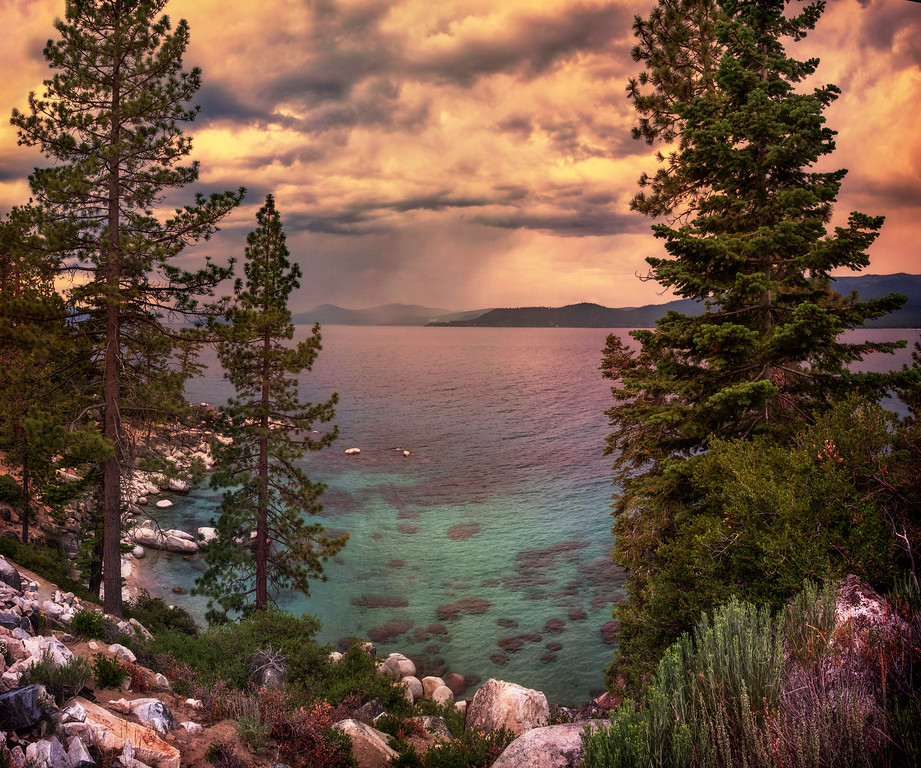 Lake Tahoe, Nevada<br /> <br /> Sky, storms, warmth, lake and the beautiful, beautiful trees. A sweet little 3-shot panorama to bring it all home.